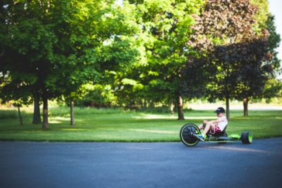 Free Stock Photos for Blogs - Boy Riding Big Wheel