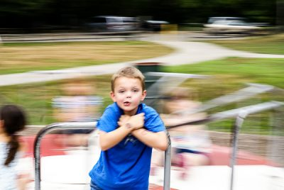 Free Stock Photos for Blogs - Kid on Merry go Round 1