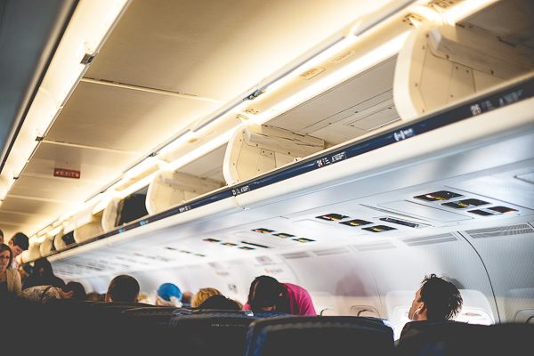 Free Stock Photos for Blogs - Airplane Overhead Luggage Compartment